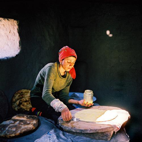 Woman baking bread in tandoor. Xinaliq Village. Azerbaijan. June, 2006